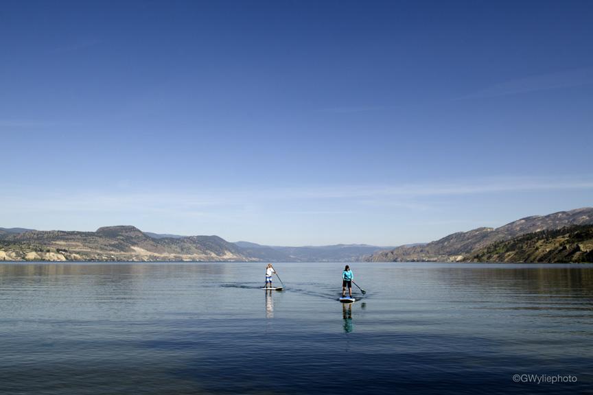 Early morning stand up paddlers Okanagan Lake